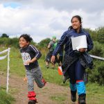 Family enjoying outdoor activities and connecting with nature at an orienteering event