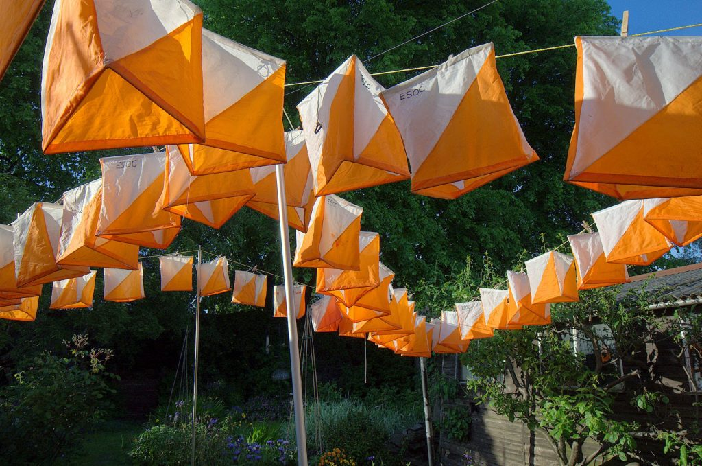 Orienteering flags hanging in the outdoors to dry
